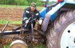 Работа плуга с трактором